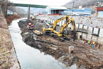 Logan Banner photo  Experts say that the construction on the Guyandotte channel will protect more than 250 homes and businesses from flood damage.