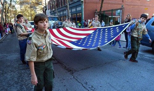 Charleston Daily Mail photo by Craig Cunningham Wilson Smith, 13, and members of Baptist Temple Boy Scout Troop 31 carried an American flag down Capitol Street during the Veterans Day parade through downtown Charleston on Tuesday morning.