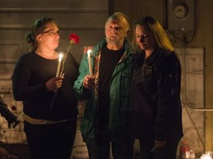 Dominion Post photo by Matt Sunday Friends of the late Jody Hunt, Ashley Ice (left) and Kerri Everd (right), console Hunt's uncle, Jim Forsythe, at a vigil held for Hunt on Wednesday, Dec. 3, at J&J Towing and Repair in Westover.