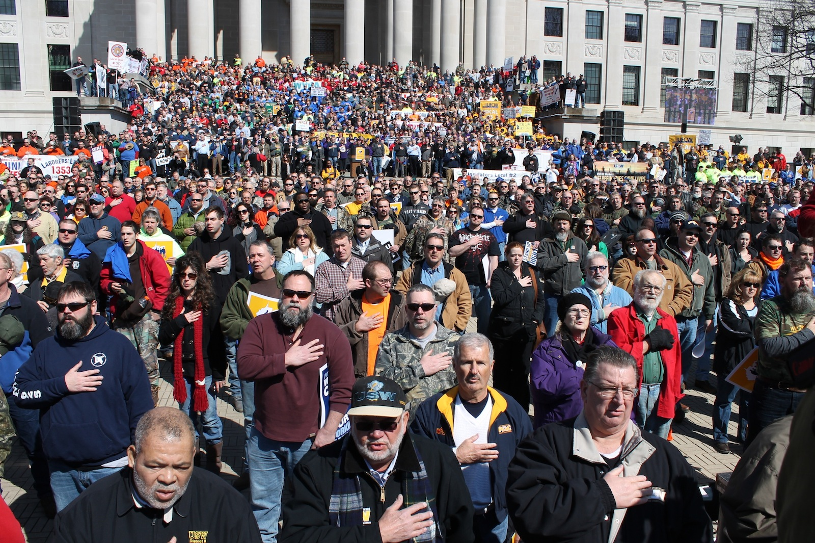 "Thousands faced the American flag and recited the Pledge of Allegiance during Saturday's ""Mountaineer Workers Rising"" Rally on the front steps of the West Virginia Capitol. National and local leaders addressed the crowd, calling for those in attendance to be political active and to vote for legislators who support worker-friendly initiatives in the Legislature. Photo by the West Virginia Press Association"
