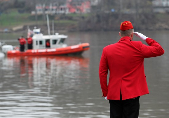 Herald-Dispatch photo by Lori Wolfe Marine Corps League member Kory Fox and members of the U.S. Coast Guard salute after wreaths were placed in the Ohio River as past of the 74th Annual National Pearl Harbor Remembrance Day program held by the Marine Corps League Post 340 of Huntington on Monday, Dec. 7, 2015 at Harris Riverfront Park.