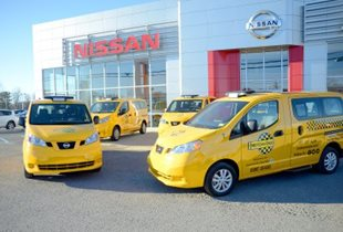Dominion Post photo by Michaela Michael The new cabs for Motown Taxi were parked outside John