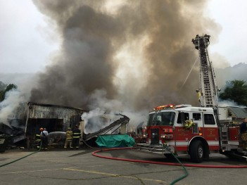 Charleston Gazette-Mail photo courtesy PInch Volunteer Fire Department  The former IGA grocery store on Main Street in Clay was destroyed by fire early Wednesday.