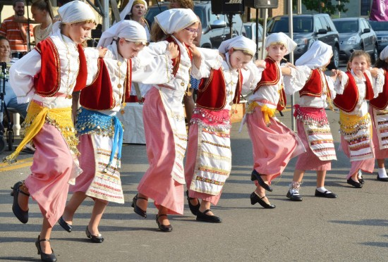 Intelligencer/Wheeling News-Register photo by Scott McCloskey The Agape Dancers perform in front of St. John the Divine Greek Orthodox Church in Center Wheeling Wednesday evening during the 16th-annual Grecian Fest, which continues from 11 a.m. to 9 p.m. daily through Saturday with plenty of food, live music, vendors and dancing.
