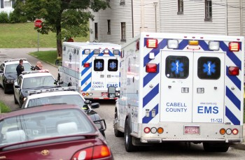 Herald-Dispatch photo by Lori Wolfe Huntington police officers and Cabell County EMS workers respond to multiple overdose calls on Sycamore Street and St. Louis Avenue Monday, Aug. 15, 2016, in Huntington.