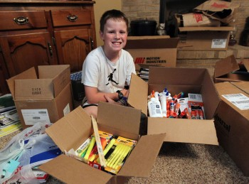 Herald-Dispatch photo by Lori Wolfe Ten-year old Justin VanMeter, a 5th grade student at Cox Landing Elementary, displays some of the items he has collected for flood victims. With help from his parents, VanMeter has already collected and delivered more than $8,000 in supplies and donations in the flood relief effort.