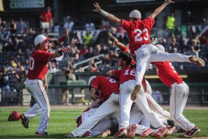 SAM OWENS | Gazette The Wahama Varsity baseball team pile on top of one another after an exhilarating win against Man High School during the Class A State Championship game at Appalachian Power Park. The White Falcons beat the Hillbillies with a score of 7-0. Ran- June 6, 2015